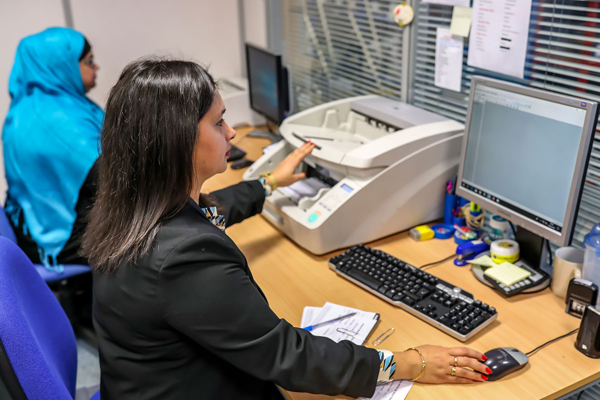 woman on computer using data capture system