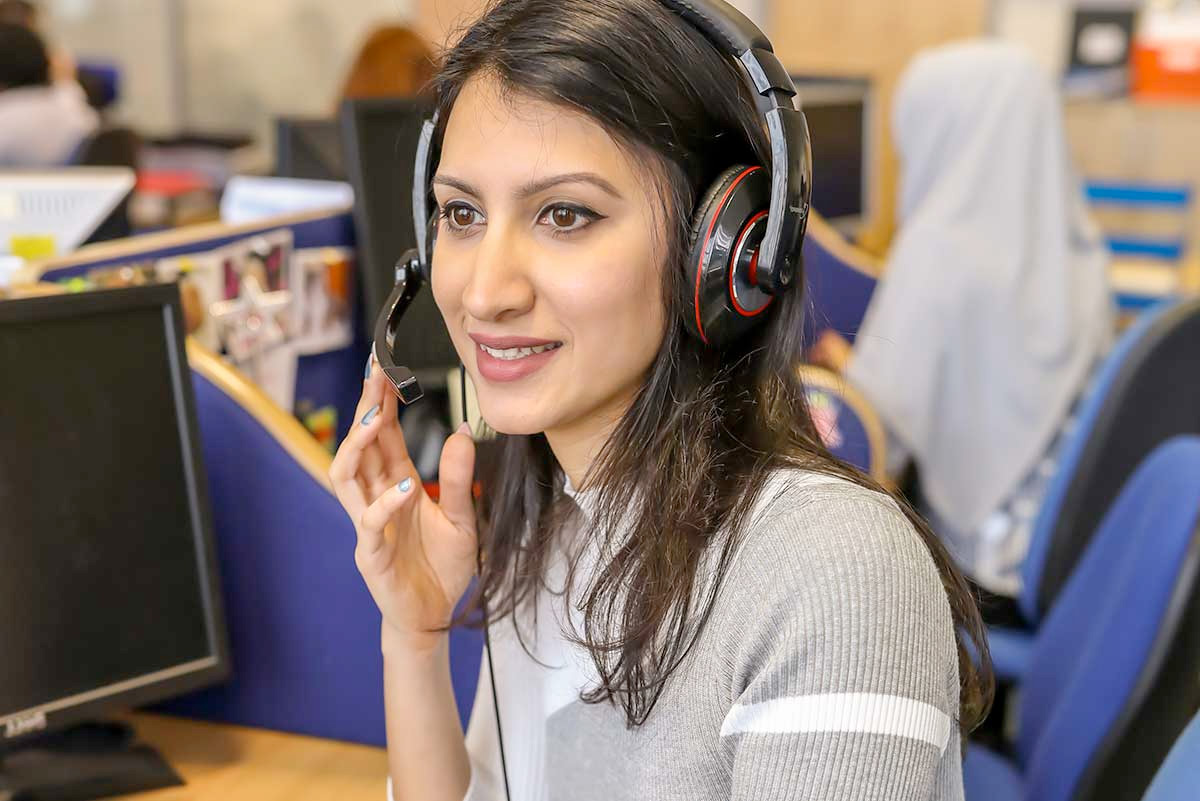 woman with headset working in charity response handling